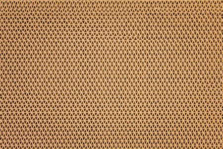 Texture brown plastic rubber doormat in ripple shape patterns on background