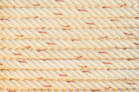 Row of white or brown rope with red striped patterns texture for background Stock Photo