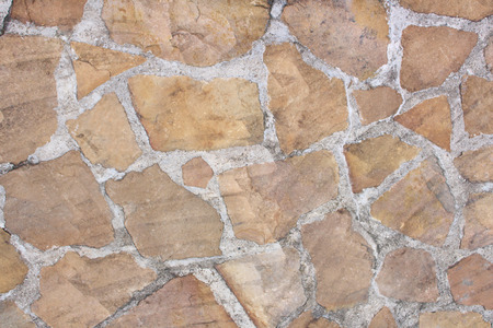 Decoration light brown rock  texture  in old concrete wall abstract background Stock Photo - 115393720