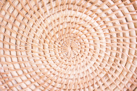 Light brown wood crafts  rattan weave in circle many layer patterns , natural  texture abstract for background