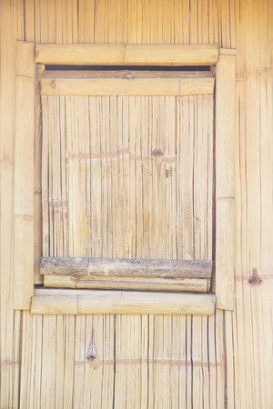 Bamboo square window on wood wall natural patterns background