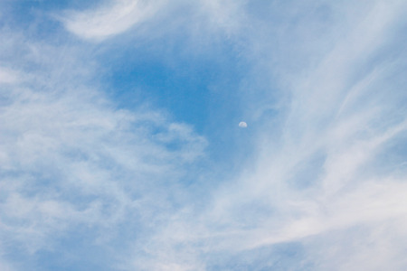 Natural cloudy patterns group with moon on blue sky background 免版税图像