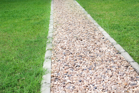 Stone walkway background with green grass , outdoor nature patterns