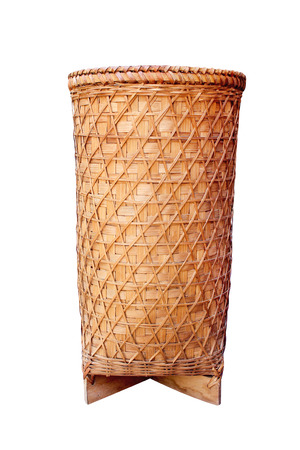 Thai traditional old woven bamboo basket or vase wood in high patterns isolated on white background with clipping path , handmade