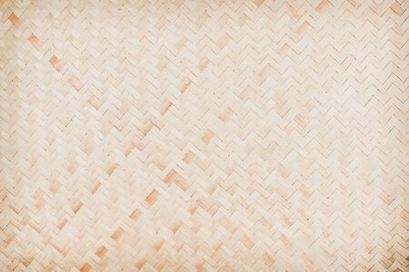 Natural old wood woven mat with line zigzag patterns texture for background , handmade