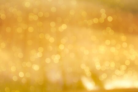 Colorful golden bokeh sparkle glitter abstract patterns for Christmas and Happy new year background Reklamní fotografie