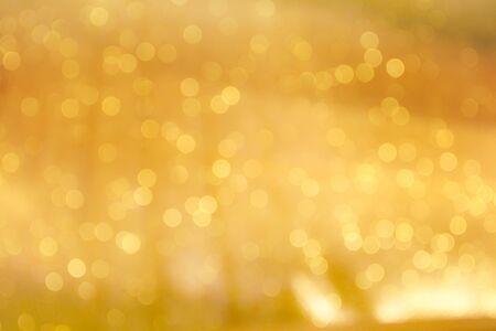 Kleurrijke gouden bokeh schittering glitter abstracte patronen voor Kerstmis en gelukkig nieuwjaar achtergrond Stockfoto