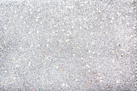Gray sparkle glitter with star shaped patterns texture abstract for christmas, new year background