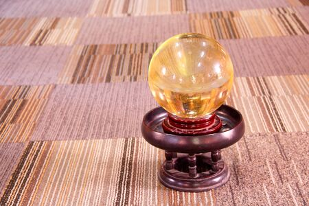 Single old glass ball on wood  tray at doi ti temple in Thailand