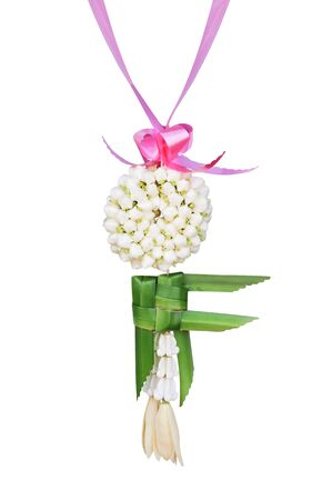 Fresh jasmine garland with green pandan leaves interlace in fish shape and magnolia champaca flower hanging isolated on white background