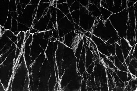 Marble black surface white cracked veins patterns abstract nature background