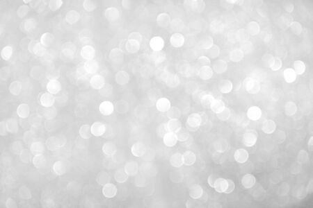 Estratto di glitter bokeh scintilla grigia su sfondo Gray