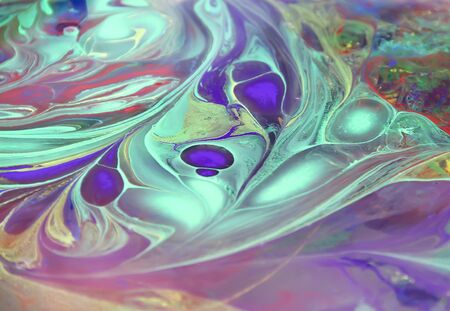Oil color floating  on water texture abstract colorful background