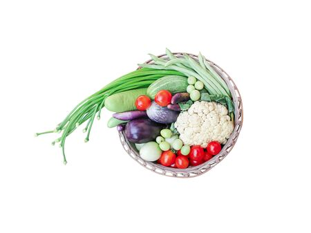 Fresh vegetables in wood basket  isolated on white background and   , top view