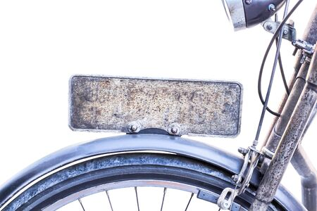 Steel blank rusty license plate on vintage bicycle isolated on white background Stockfoto