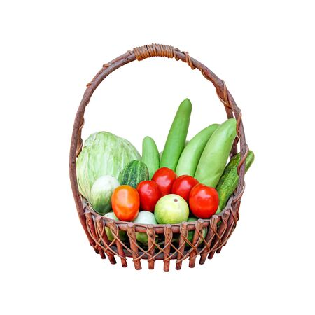 Organic vegetables in wood basket isolated on white background