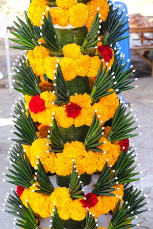 Rice offering  decoration with yellow marigold flowers and  banana leaf folded in  ancient Thai style call  Pan Bai Sri