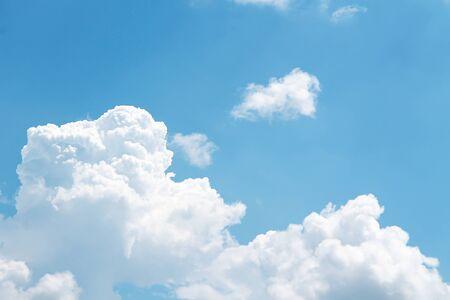 Fluffy clouds patterns on bright bluesky background Banco de Imagens