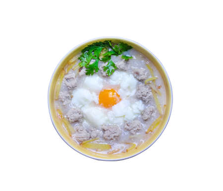 Rice porridge with egg , pork ang ginger  top view isolated on white background