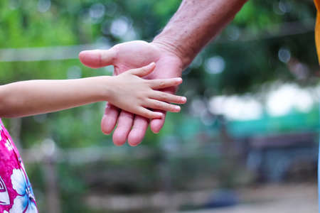 Grandchild hands and grandfather , familly asian background Stock Photo