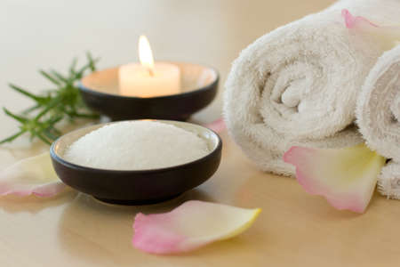 Health spa and wellness with bath salts, candles, and towels