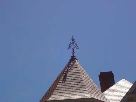 Windwijzer op rood sate dak