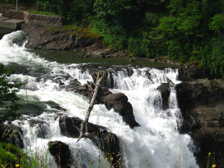 waterfall with rocks and greenery Stock Photo