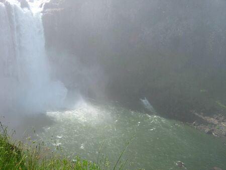 waterfall with spray and river