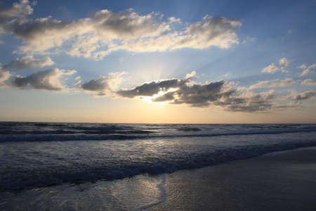 the sun rises over the beautiful Atlantic Ocean in Daytona Beach, Florida photo