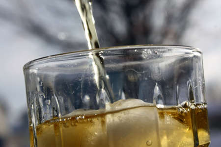 a refreshing glass of apple juice being poured Stock Photo