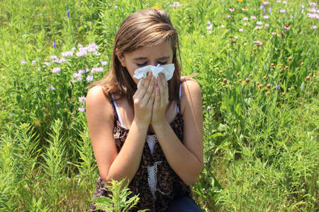allergens: Woman blowing nose