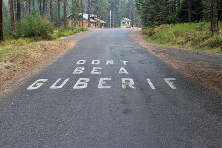 Road surface marking at the entrance to Winchester Lake State Park in Idaho warns campers 写真素材