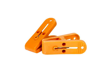 Closeup image of little orange office clothespins isolated on a white background