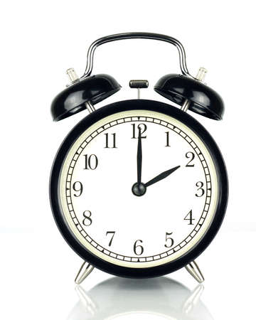 Alarm Clock isolated on white, in black and white, showing two oclock.