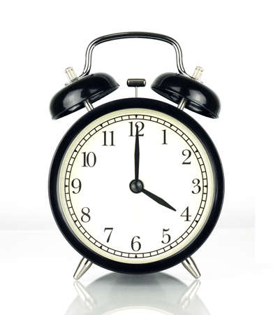 oclock: Alarm Clock isolated on white, in black and white, showing four oclock. Stock Photo