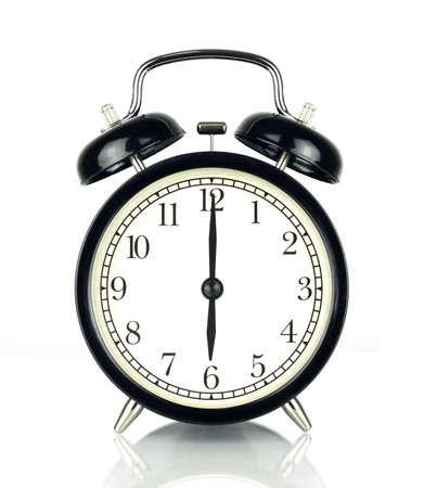 Alarm Clock isolated on white, in black and white, showing six oclock.