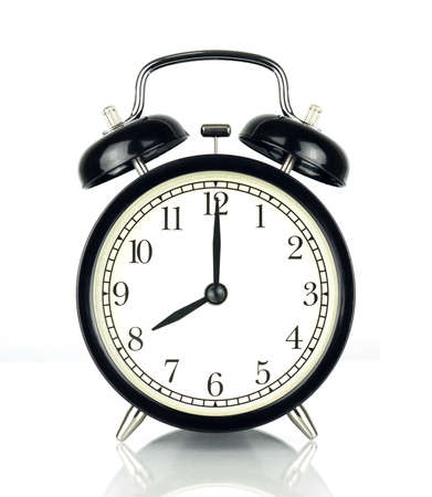 pm: Alarm Clock isolated on white, in black and white, showing eight oclock. Stock Photo