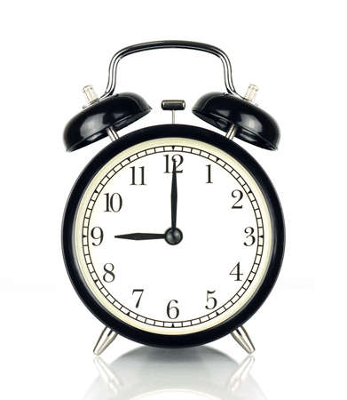 oclock: Alarm Clock isolated on white, in black and white, showing nine oclock.