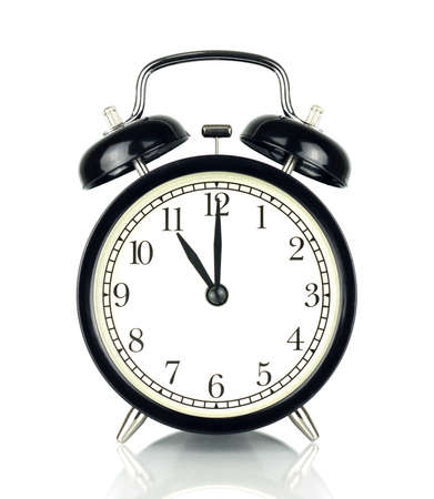 Alarm Clock isolated on white, in black and white, showing eleven oclock.