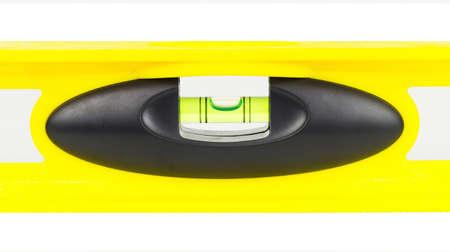 Gele bouwniveau, balansregelaar, geïsoleerd op een witte achtergrond. Stockfoto
