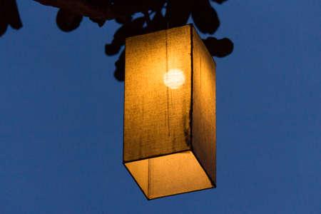 triplex: Nights lights of lamps on tree. Stock Photo