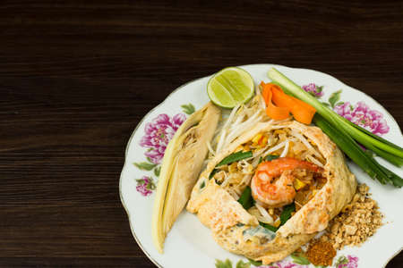 Pad Thai Goong Sod, thin rice noodles fried with tofu, vegetable, egg, peanuts and shrimp.