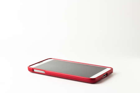 six objects: Red smartphones with blank screen on white background. Stock Photo