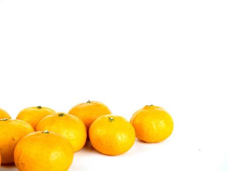 Mini orange fruit on white background. Stock Photo
