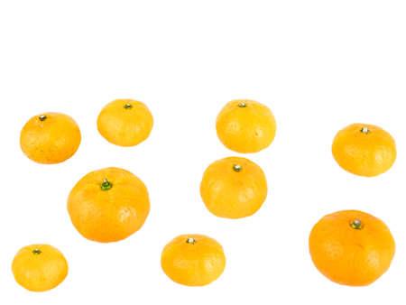 Close-up view of fresh mini orange fruit isolated on white background.