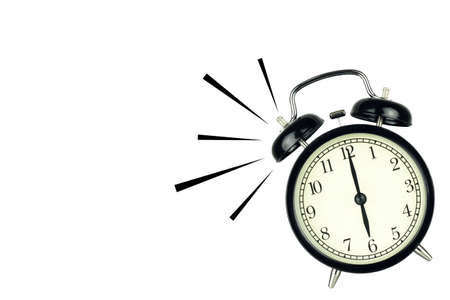 Alarm Clock wake-up time isolated on white background, showing six o'clock. Foto de archivo