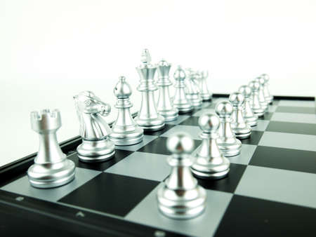Silver chess figures on board for game start, Intellectual sport and Tactic game. Stok Fotoğraf