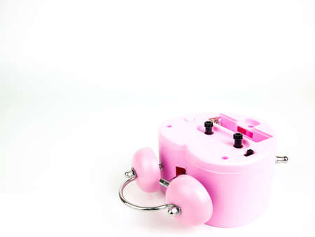Pink Alarm clock falling on white background, Broken heart.