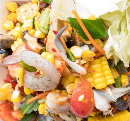 Spicy papaya corn salad with shrimp and fresh crab, Papaya corn salad is the most popular of women in Thailand.
