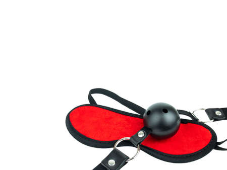 Sex toy black leather latex strap with black ball and eye mask, BDSM Sex attributes, Sadism Masochism Bondage Discipline Belting. isolated on white, Clipping path.